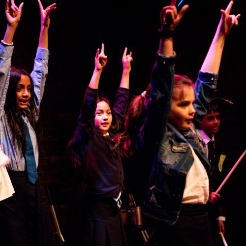 Stars children performing in theatre show