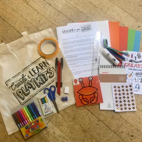 An image of a tote bag with Create & Learn PlayKit logo on, and the basic art materials that are including in the bag.