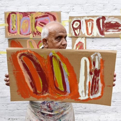 Chandrakant Patel with his paintings on card.