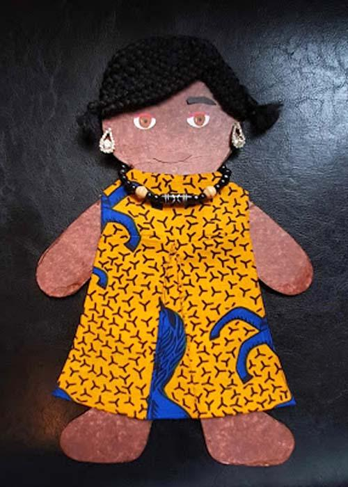 Cut out doll of an African woman in an African print dress