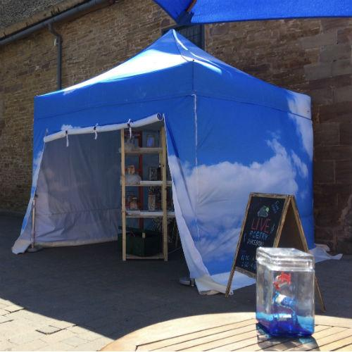 Sky-and-cloud tent with jars on shelves inside